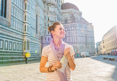 Woman with map in front of cattedrale in florence Stock Photography