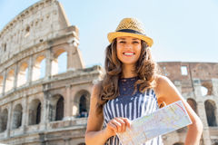 Woman with map in front of colosseum in rome Royalty Free Stock Images