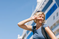 Woman with map, in front of cruise liner Royalty Free Stock Photos