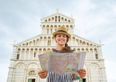 Woman with map in front of duomo di pisa, pisa Royalty Free Stock Photography
