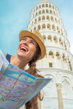 Woman with map in front of leaning tower of pisa Royalty Free Stock Photography