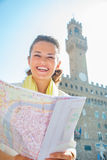 Woman with map in front of palazzo vecchio, Italy Stock Images