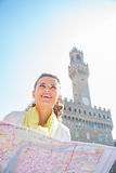 Woman with map in front of palazzo vecchio, Italy Royalty Free Stock Photo