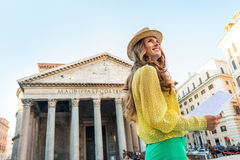 Woman with map in front of pantheon in rome Stock Photos