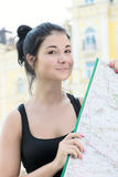Woman with map in hands Stock Image