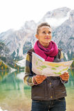 Woman with map on lake braies in south tyrol Royalty Free Stock Image