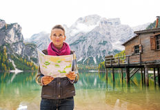 Woman with map on lake braies in south tyrol Stock Image