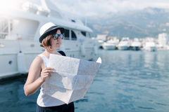 Woman with map near luxury ships Royalty Free Stock Images