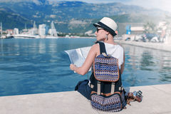 Woman with map near luxury ships Royalty Free Stock Photo