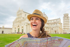 Woman with map on piazza dei miracoli, pisa, italy Stock Images