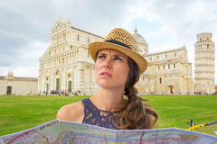 Woman with map on piazza dei miracoli, pisa, italy Stock Image