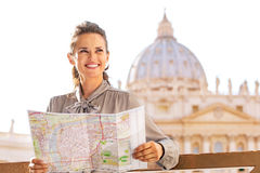 Woman with map on piazza san pietro in vatican Stock Image