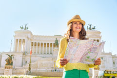 Woman with map on piazza venezia in rome, italy Royalty Free Stock Photography