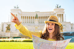 Woman with map on piazza venezia in rome, italy Stock Photo