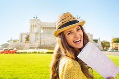 Woman with map on piazza venezia in rome, italy Royalty Free Stock Photo