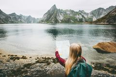 Woman with map planning route sightseeing Lofoten islands. In Norway Travel lifestyle concept adventure outdoor summer vacations Royalty Free Stock Photos