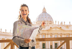 Woman with map pointing on basilica di san pietro Stock Image