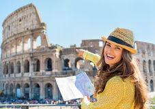 Woman with map pointing on colosseum in rome Stock Photo