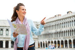 Woman with map pointing on piazza san marco Royalty Free Stock Photos