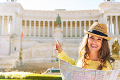 Woman with map pointing on piazza venezia in rome Royalty Free Stock Photos