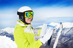 Woman with map of ski tracks on the mountain peak Stock Photography