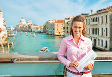 Woman with map standing on bridge in venice, italy Royalty Free Stock Photos