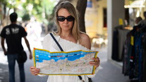 Woman with map. Woman with map in the street stock video