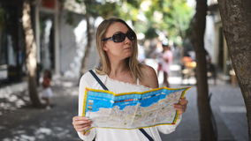 Woman with map. Woman with map in the street stock video footage