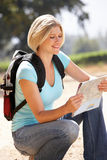 Woman with map on walking in country Royalty Free Stock Photos