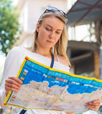 Woman with a map. Royalty Free Stock Photography