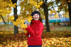 Woman and maple Royalty Free Stock Photo