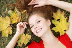Woman with maple leaf Royalty Free Stock Photos