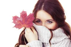 Woman with maple leaf hiding her face in sweater Royalty Free Stock Images
