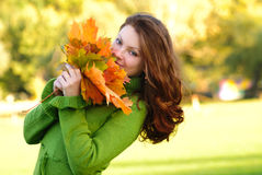 Woman with maple leaves Stock Image