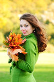 Woman with maple leaves royalty free stock photo
