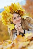 Woman with maple leaves at autumn Stock Image