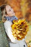 Woman with maple leaves at autumn Royalty Free Stock Photo