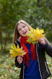 Woman with Maple leaves Royalty Free Stock Images