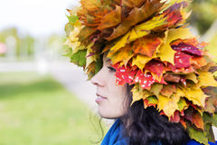 Woman with maple leaves on head Royalty Free Stock Photos