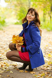 Woman with maple posy. Outdoor portrait of   woman with maple posy Royalty Free Stock Photography
