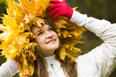 Woman in maple wreath Royalty Free Stock Images