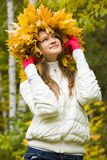 Woman in maple wreath Stock Photos