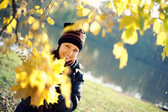 Woman with maple yellow leaves Royalty Free Stock Images