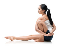 Woman in marachiasana yoga position Royalty Free Stock Photos
