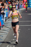 Woman marathon runner Stock Photos