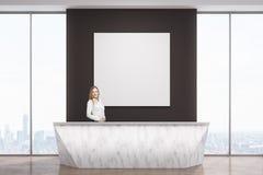 Woman at marble reception desk Stock Photos