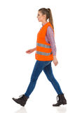 Woman Marching In Orange Reflective Vest Royalty Free Stock Photography