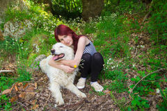 Woman with maremma sheepdog Royalty Free Stock Image