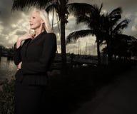 Woman by the marina Stock Photo