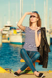 Woman in marina against yachts in port Stock Photography